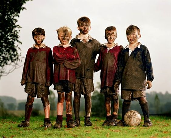 mud soccer players photo